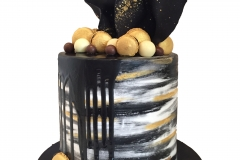 Modern black, gold and white cake